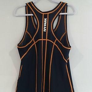 IVY PARK• black contrast orange stitching tank top